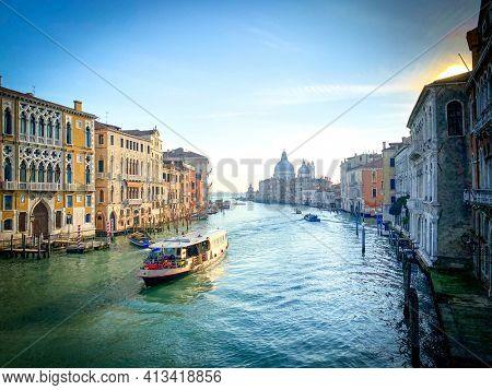 View of a vaporetto on the Grand Canal and Basilica Santa Maria della Salute from the Ponte dell'Accademia in Venice, Italy