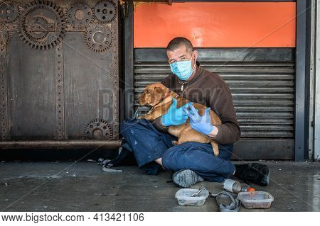 Hungry Sick Homeless Beggar Man On The Street With His Dog Begging For Money And Food To Eat Wearing