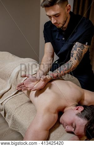 Chiropractic, Osteopathy, Manual Therapy, Acupressure. Therapist Doing Healing Treatment On Man