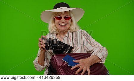 Senior Woman Tourist Photographer Taking Photos On Retro Camera And Smiling On Chroma Key Background