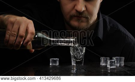 Alcoholic Guy Drinking Cold Transparent Alcohol Drink Sake, Tequila Or Rum. Man Pouring Up Frozen Vo