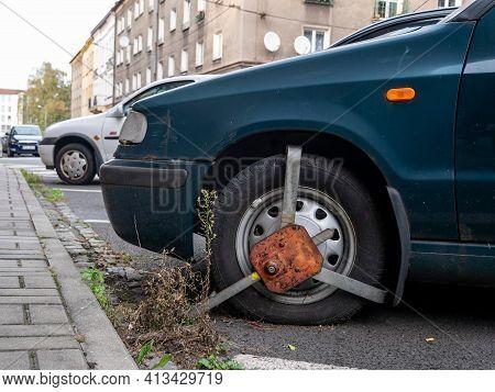 Cesky Tesin, Czechia - September 28, 2016: Wheel Clamp Mounted On A Green Skoda Felicia Car Because