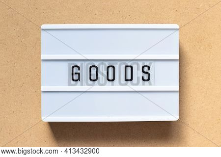 White Lightbox With Word Goods On Wood Background