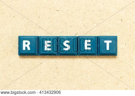 Tile Alphabet Letter In Word Reset On Wood Background