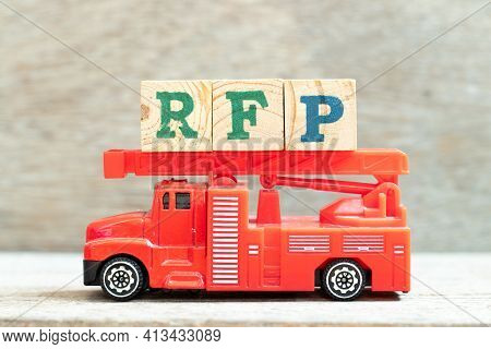 Fire Ladder Truck Hold Letter Block In Word Rfp (abbreviation Of Request For Proposal) On Wood Backg