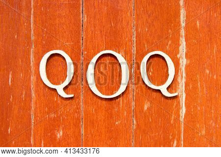 Alphabet Letter In Word  Qoq (abbreviation Of Quarter On Quarter) On Old Red Color Wood Plate Backgr