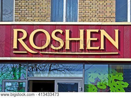 Kiev, Ukraine - Mar 04, 2021: Roshen Confectionery Corporation Logo On The Facade Of Shopping Mall B