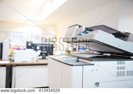 Close-up The Copier Machine In Office Copy Room For Scanning Document Printing A Sheet And Xerox Pho