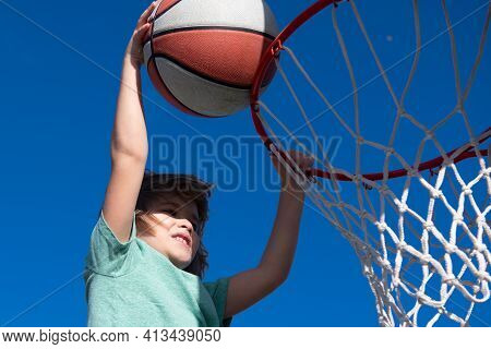 Excited Funny Kid Playing Basketball. Closeup Child Portrait. Funny Child Face. Little Basketball Pl