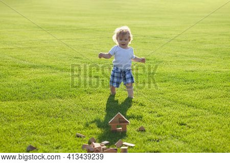 Insurance Kids. Happy Childhood. Little Baby Learning To Crawl Steps On The Grass. Concept Childrens