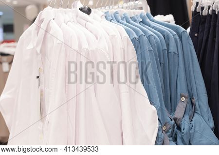 Knitwear On Hangers In A Large Store, Outerwear
