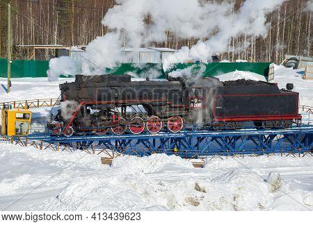 Ruskeala, Russia - March 10, 2021: Old Soviet Mainline Steam Locomotive L-2198 It Unfolds On A Turni