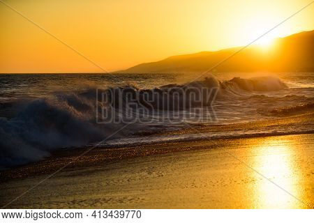 Ocean Seascapes. Sea Waves. Sunset On Beach Resort