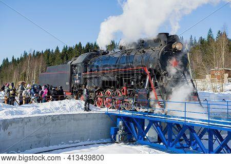 Ruskeala, Russia - March 10, 2021: Soviet Retro Steam Locomotive Lv-0522 Enters The Turning Circle O