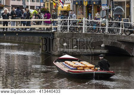 Alkmaar, Netherlands - May 18, 2018: Cheese Market Transporting Through The Canal