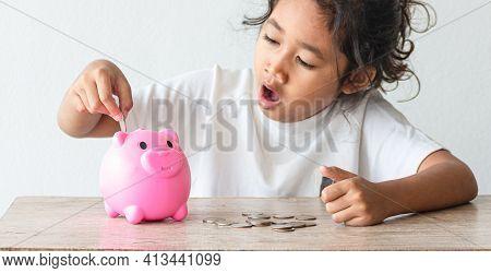 Asian Girls Save Money In Savings Pig Pink Pig