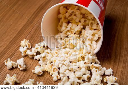Heap Of Delicious Popcorn Isolated On Wooden Background. Popcorn Close-up