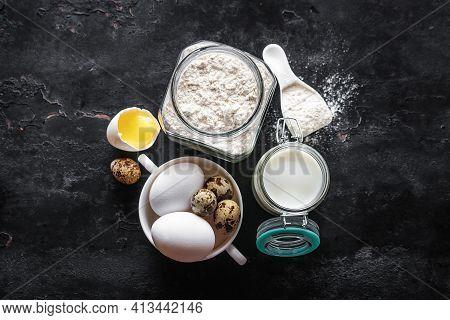 Ingredients For Baking On A Black Background, Milk, Eggs, Flour
