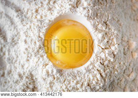 Chicken Yolk On Flour Close-up