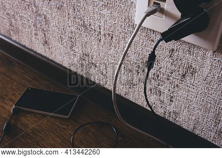 Socket And Connected Phone Smartphone On Charging