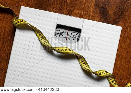 Scales And Measuring Tape Diet Concept