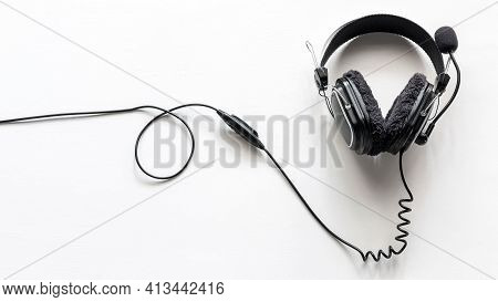 Headphones With A Microphone On A White Background Concept Of Remote Work, Operator, Technical Suppo