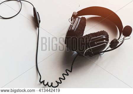 Black Headphones With Microphone On White Background