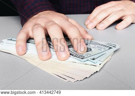Taking A Bribe With Money Dollars Close-up Hand And Money