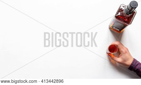 Bottle Of Whiskey And Hand Holds A Glass Of Alcohol Alcoholism Concept On White Background With Plac