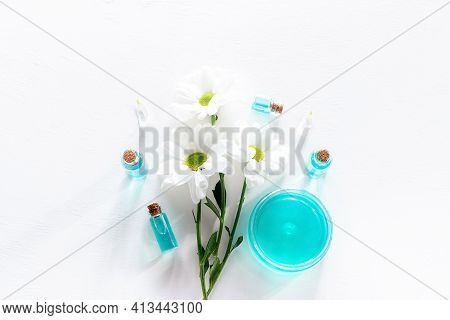 Flowers And Natural Oils On White Background
