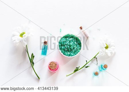 Bath Salt And Home Cosmetics Cream Oils And Flowers On White Background