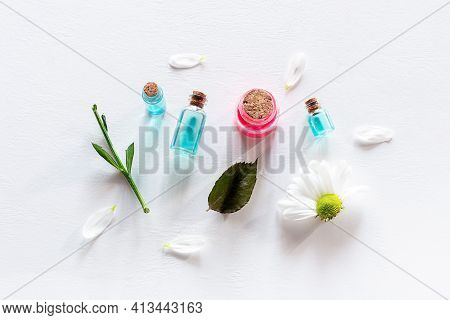 Samples Of Natural Cosmetics And Flowers On A White Background