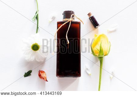 Home Made Cosmetics And Flowers On White Background Close Up