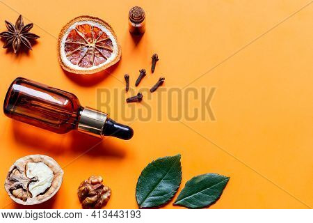 Perfume From Natural Ingredients With Place For Text On Yellow Background