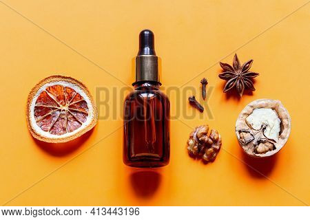 Perfume From Natural Ingredients Close Up On Yellow Background