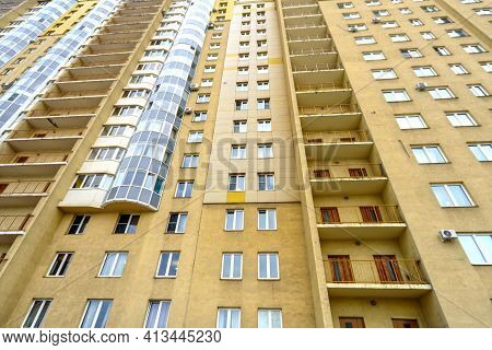 New Building Of A Multi-storey Residential Building. Multi-storey Residential Building In Brown And
