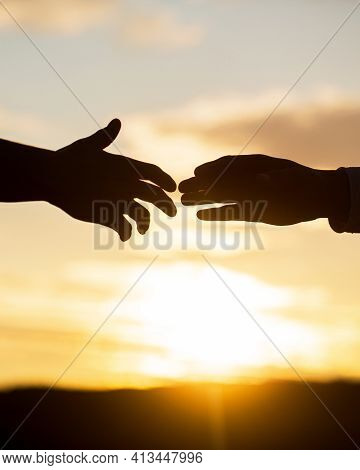 Rescue, Helping Gesture Or Hands. Two Hands Silhouette On Sky Background, Connection Or Help Concept
