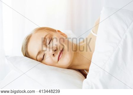 Beautiful Young Woman Sleeping In Bedroom Comfortably And Blissfully
