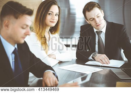 Business People Or Lawyers Discussing Questions At Meeting In Modern Office. Unknown Businessman And
