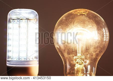 Led And Incandescent Light Bulb Powered On. Energy Savings With Modern Technology.