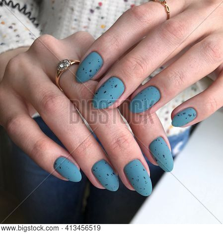Stylish Trendy Blue Matte Female Manicure.hands Of A Woman With Blue Manicure On Nails