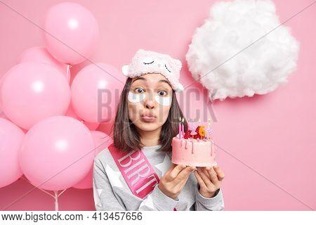 Lovely Surprised Asian Woman Keeps Lips Folded Dressed In Nightwear Enjoys Domestic Party Celebrates
