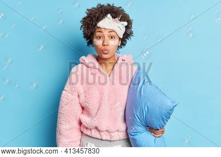 Pretty Curly Haired Woman Keeps Lips Folded Wants To Kiss You Undergoes Beauty Procedures After Awak