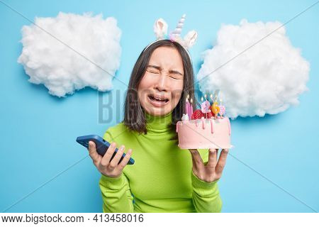Frustrated Unhappy Asian Woman Cries Holds Smartphone And Birthday Cake Upset Noone Congratulated He