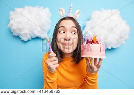 Brunette Asian Woman Licks Lips With Tongue Has Temptation To Eat Tasty Cake Holds Toothbrush Has Pr