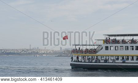Istanbul, Turkey - March, 2021: Seascape With Tourist Boats On Background Of City On Coast. Action.