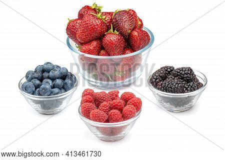 Fresh Berries Strawberries, Raspberries, Blackberries And Blueberries In Glass Bowls Isolated On Whi