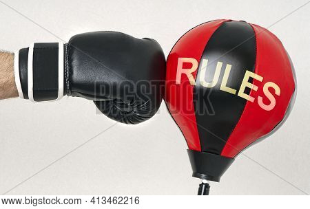 Hit The Rules Concept With A Strong Man's Hand In A Boxing Glove Hits The Punching Bag With Text Rul