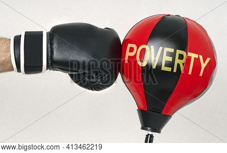 Fight The Poverty And Misery Concept With A Strong Man's Hand In A Boxing Glove Hits The Punching Ba