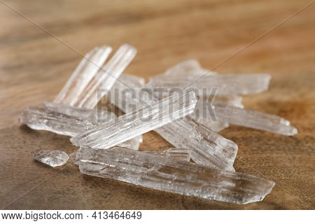 Menthol Crystals On Wooden Background, Closeup View